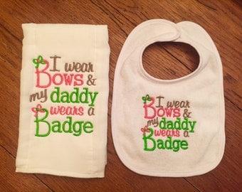 I wear bows my daddy wears a badge baby girl burpcloth and bib set