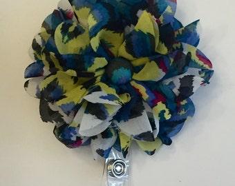 Colorful flower retractable badge clip