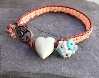 Beaded leather single wrap bracelet, peach apricot colour, ceramic heart bead, flower cluster.