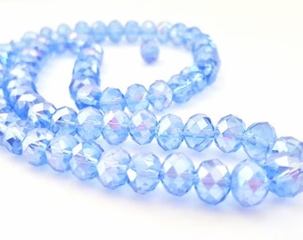 16 Inch Strand of Periwinkle Blue AB Crystal Beads.  8 X 6mm in Size.  71 Beautiful Crystal Beads.  Very Glitzy and Glam!!