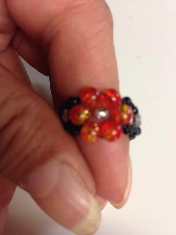 Cracked orange flower ring