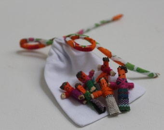Worry dolls presented in a mini sac and finished with Liberty ribbon