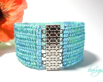 Wide bracelet light blue turquoise threaded