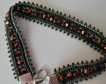 Beautiful green shiny bracelet finished with Swarovski crystals