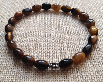 Mens 6x8mm Tigers Eye stretch bracelet with sterling silver Bali bead