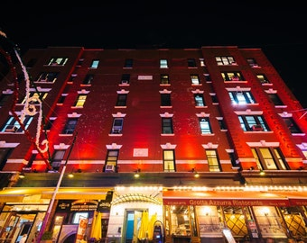 Red building in the Lower East Side at night, in Manhattan, New York. | Photo Print, Stretched Canvas, or Metal Print.
