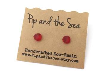 Crimson red faceted eco-resin earrings. Surgical steel studs.