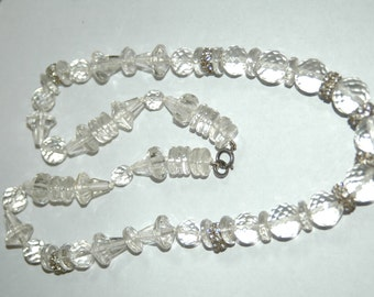 An exquisite vintage beaded glass necklace with diamonte spacers.