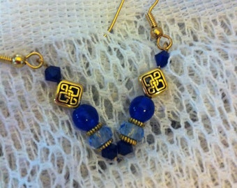Blue and gold pierced earrings with Celtic knot beads.