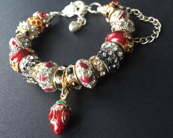 Red, black and crystal charm bracelet.