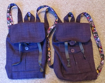 Purple mini canvas rucksack, flower lining