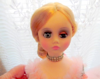 Madame Alexander, Elise Ballerina  doll. She is wearing a gorgeous pink tutu, and rhinestone necklace. .  Original box. Very good.