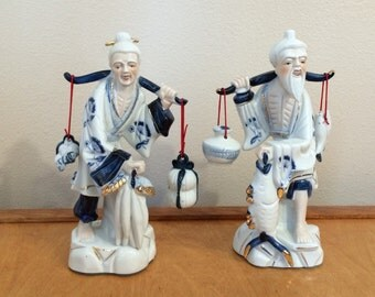 Man and Woman Asian Porcelain Figurine  - Going to Market