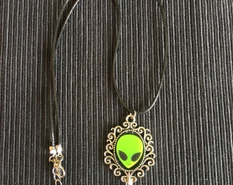Alien in mirror necklace.