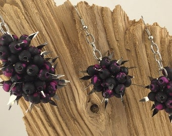 Sparkle and Spikes amid a Sea of Black Beads with Splashes of Purple.