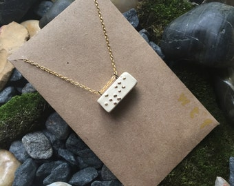 """Braille necklace in """"wtf"""""""