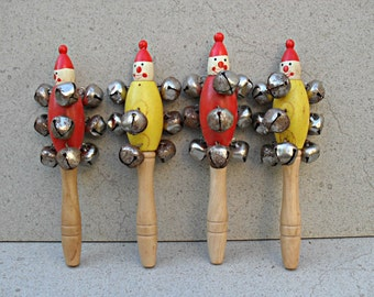 Four vintage baby rattles / wooden clown rattles / clown bell rattles .