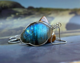 Oval shape Labradorite pendant silver wire wrapped with a silver plated necklace