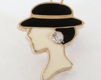 Woman with hat charm