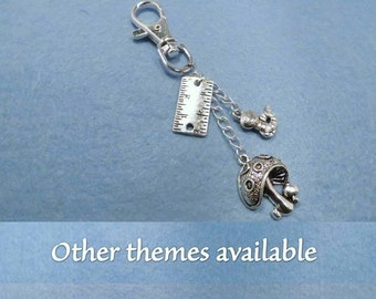Alice in Wonderland bag charm with the theme of your choice.