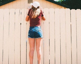 Slightly distressed high waisted shorts levi brand