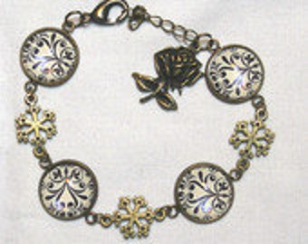 Handmade bracelet baroque motifs black and off-white, pink and flakes bronze cabochon glass substrate