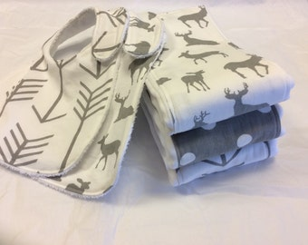 Set of 3 baby burp cloths and 2 bibs in gray and white deer, arrows, and polka dots.