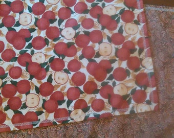 Reversible apple and paisley table runner.