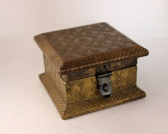 Vintage wooden box covered with brass.