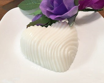 Swirled heart-shaped soap made with goats milk and tinted with ivory lace sparkle