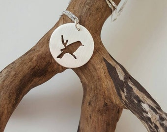 Sterling silver bird on a branch pendant