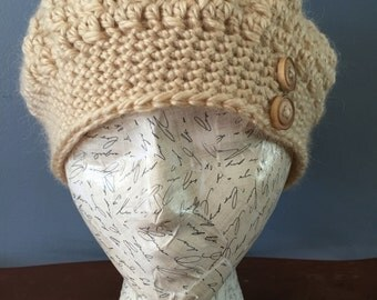 Woman crochet tan slightly slouch beanie