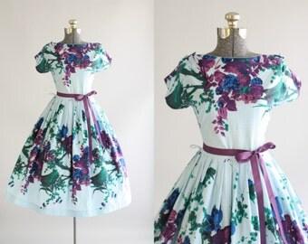 Vintage 1950s Dress / 50s Cotton Dress / Purple and Blue Floral Border Print Dress w/ Waist Tie M