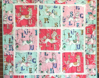 Carousel Horses Patchwork Quilt for baby or child made from Dear Stella cotton fabrics.
