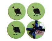 Round Coasters, Set of 4, hand decorated with Guinea Fowl, hand textured lime green and hand tied with a black ribbon