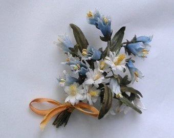 A bouquet of wild flowers in vintage style for doll