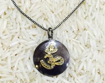 OM diamond pendant, chram . Set in sterling silver, pave diamond.
