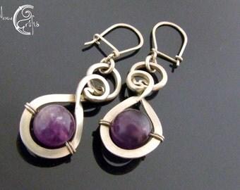 Delicate wirework earrings adorned with amethyst gemstones