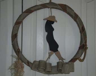 Western Rope with with cowgirl, bling on hat and boots. rope is wrapped with burlap ribbon.