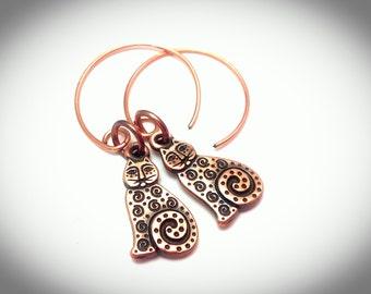 Folk art style copper cat hanging earrings