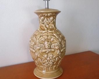 1960's cherub angel lamp in harvest gold glaze over ceramic