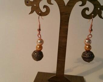 Bronze aztec style drop earrings