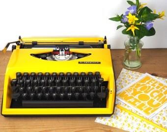 vintage typewriter Adler Tippa - bright yellow in good condition
