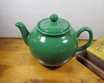 Green Ceramic and Porcelain Teapot