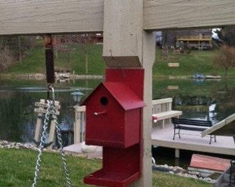 Metal birdhouse and feeder combo.
