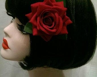 red  velvet rose with green leaves