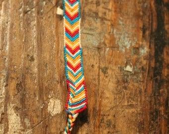 Friendship Bracelet - Freeform design - bordered chevron - Southwest colors - button fastener