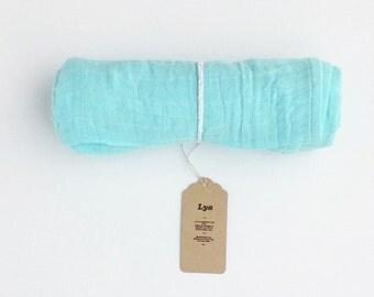 Blue muslin swaddle blanket