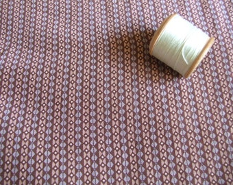 Over 4metre length of brown geometric patterned silk dressmaking fabric