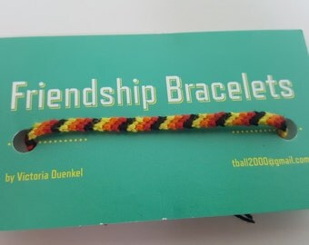 D10 black/red/orange/yellow friendship bracelet